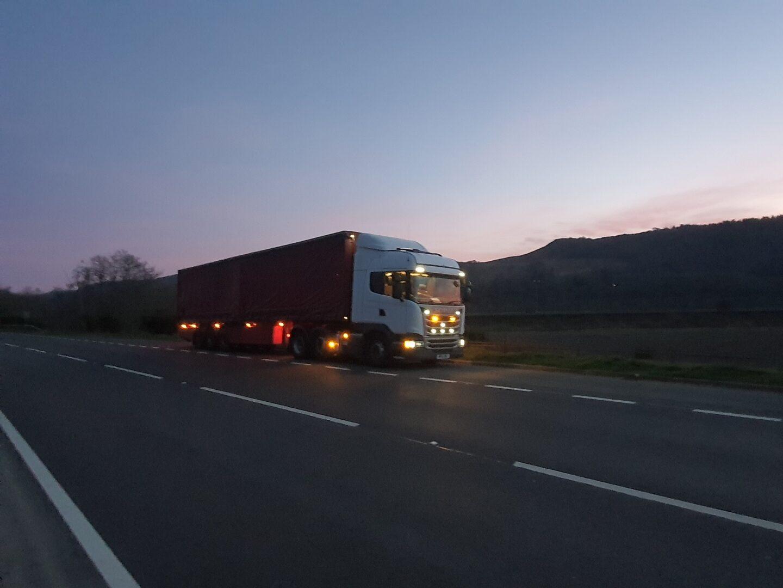 TTM Distribution Trucks/ truck driving on the highway
